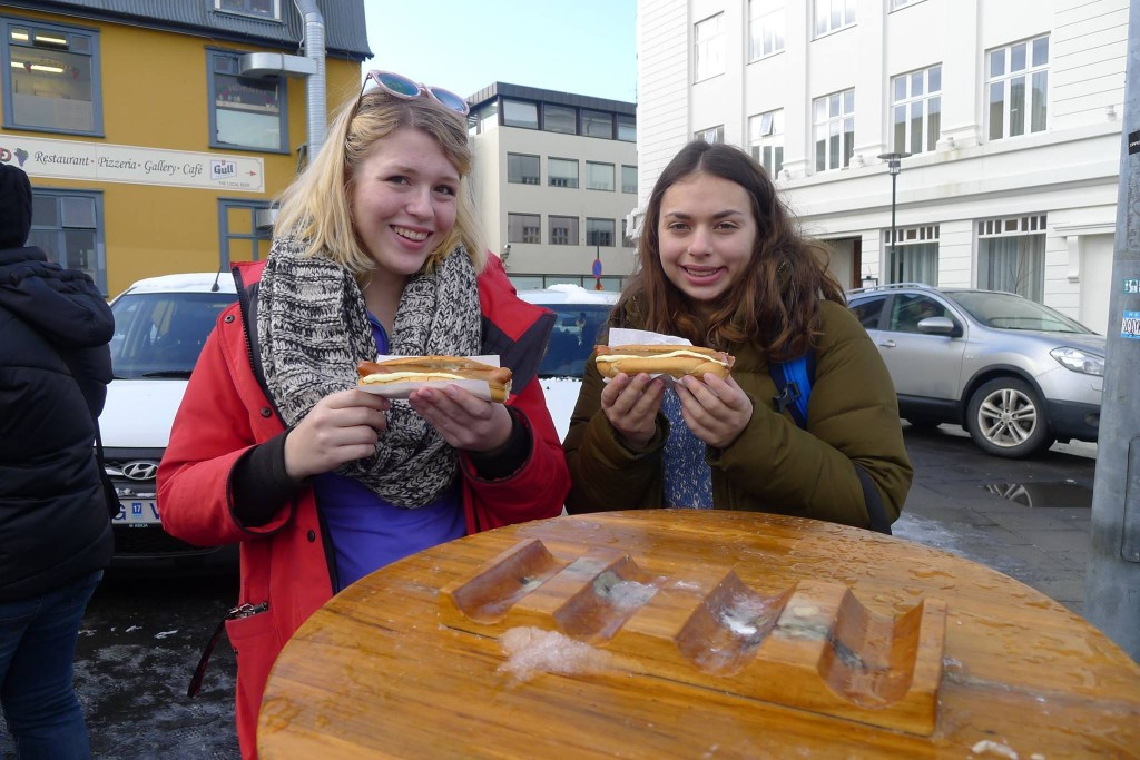 Icelandic Kristin and Amelia with hotdogs in Reykjavik